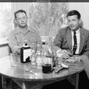 Jack and Earl Sears enjoy some scotch. Oakland, California c.1954-55.