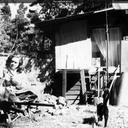 Norma outside the shack on Valley View Road, soon after buying and moving in. The house was modest, but the location was pleasant and safe for the cats. Oakland, California c.1954-55.