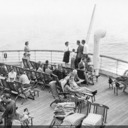 Norma sitting on the fantail with friends, aboard Nieuw Amsterdam, bound for Southampton.